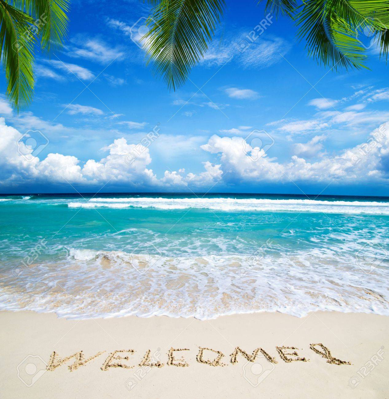 welcome written in a sandy tropical beach Stock Photo - 18512977