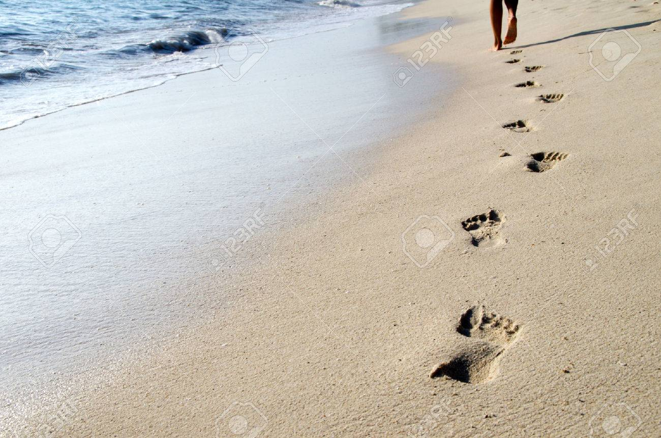 Footprints in wet sand of beach Stock Photo - 22605427
