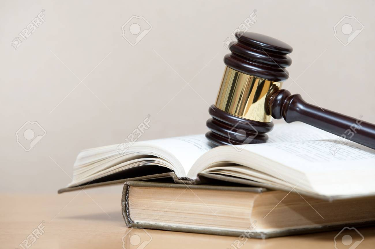 wooden gavel and books on wooden table Stock Photo - 28213974