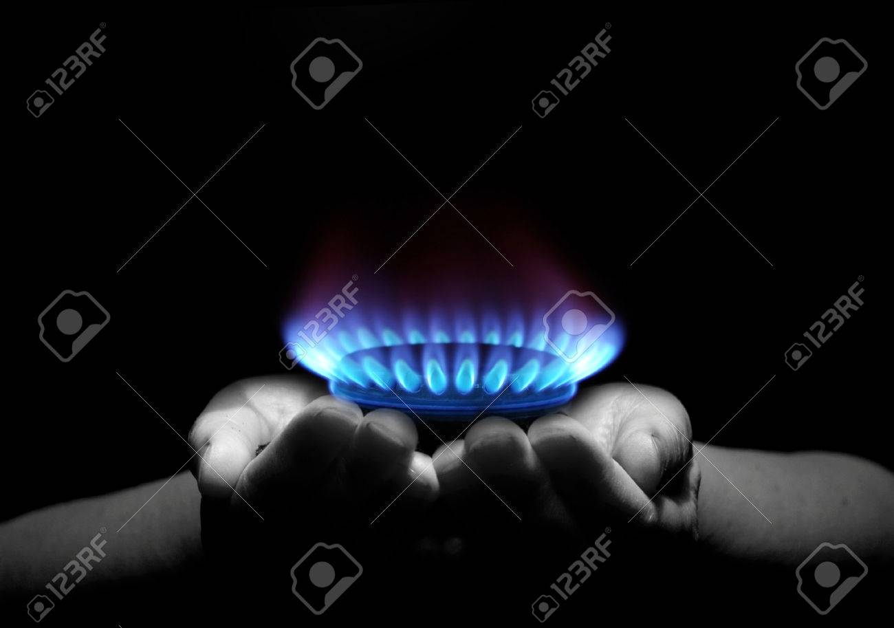 Hands holding a flame gas Stock Photo - 30278950