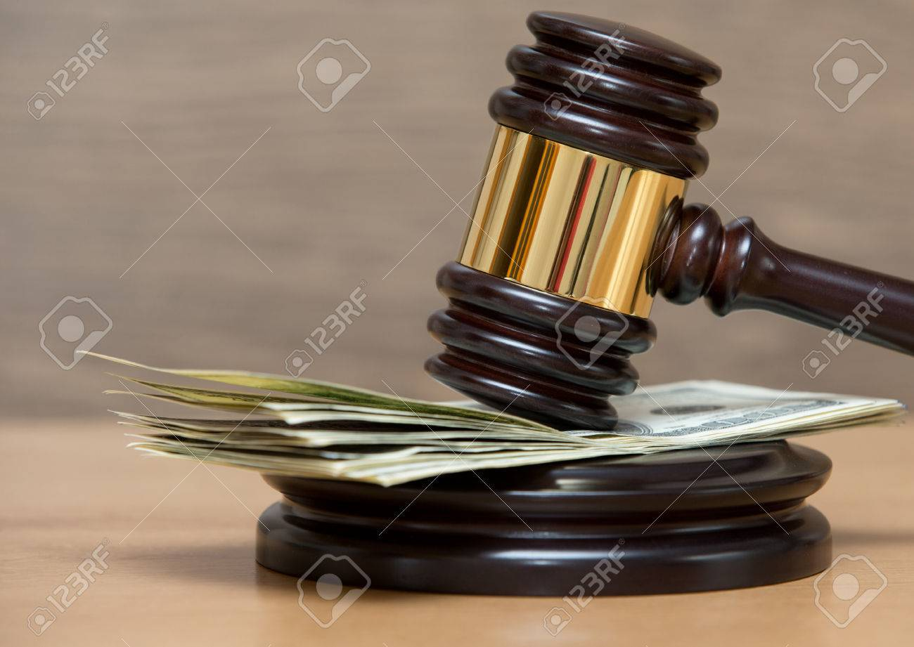 Law gavel on a stack of American money Stock Photo - 32420632