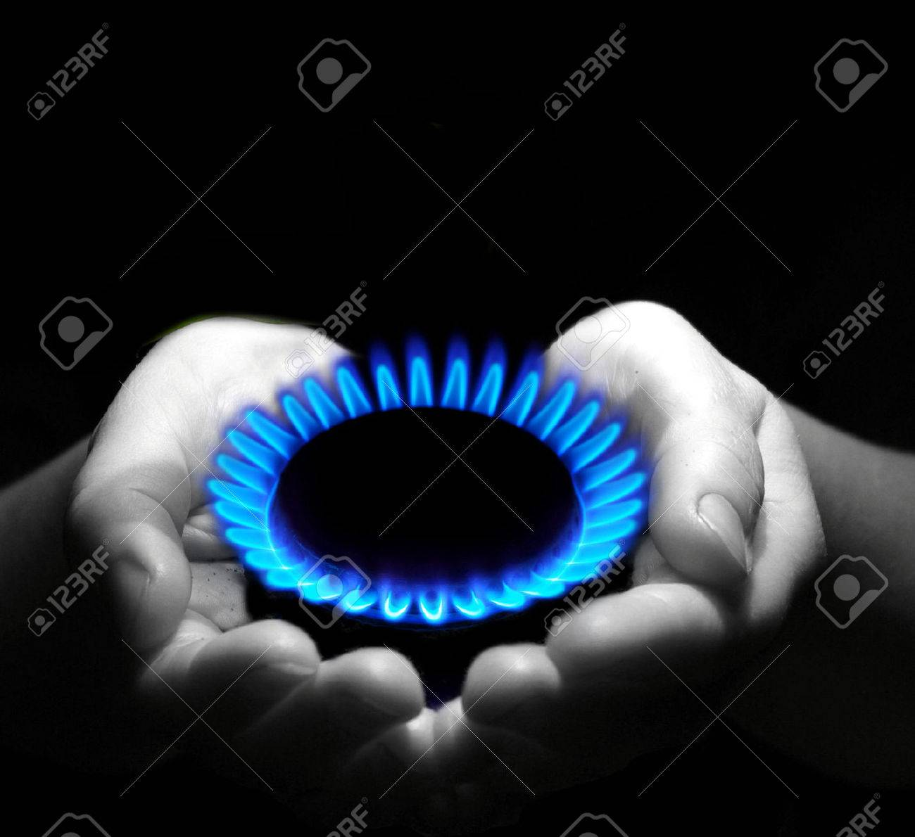 Hands holding a flame gas Stock Photo - 33925031
