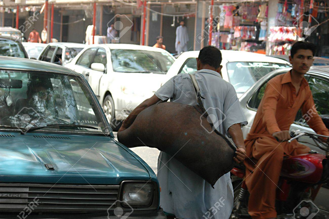PAKISTAN_KARACHI_Maski is words how deliver water for sale  to those unfortunate people of Pakistan ,mask is made of animal skine,like cows and ox or bufflos  man  carry water on his shoulder to make sale and struggle for daily life 18 May 2012  Stock Photo - 14146579