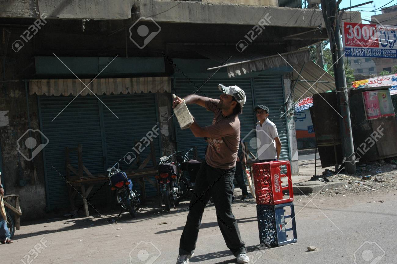 Karachi Pakistan_ Pakistani Playing Circket On Street Cricket Sport Is In Pakistani Blood Pakistani Do