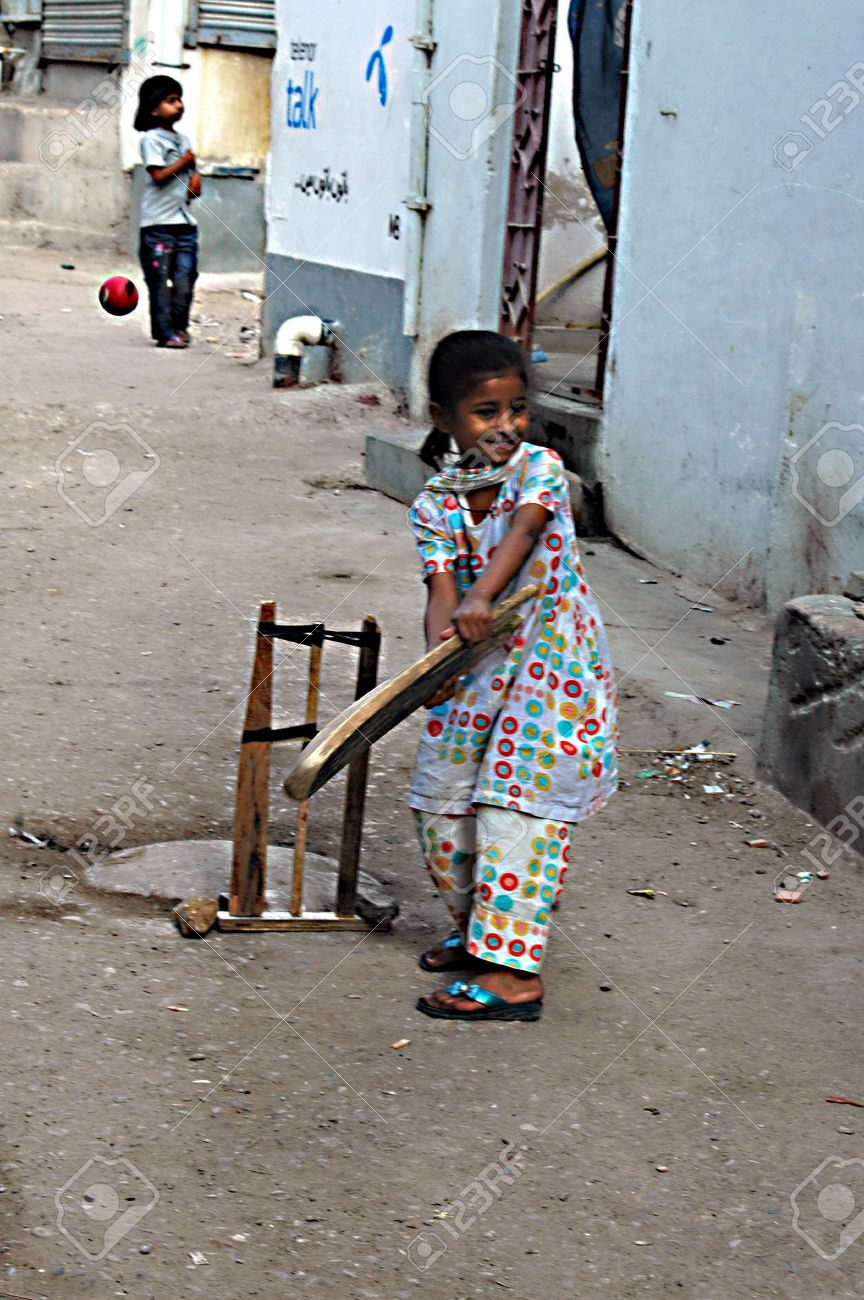 Karachi Pakistan_ Pakistani Christian Children Playing Cricket In Street Of Christian Area Azam Basti And
