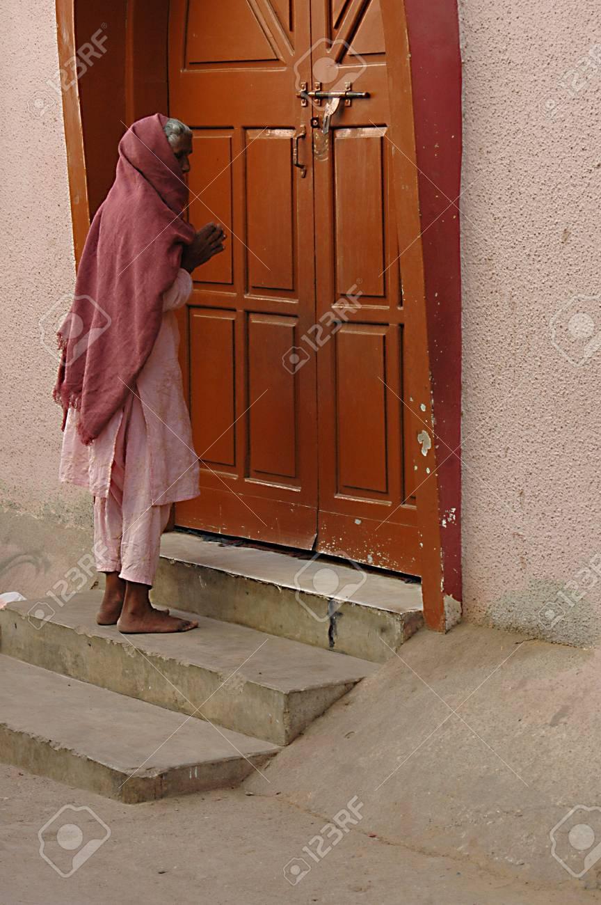 KARACHI/PAKISTAN_ Eldlere christian woman saying her prayer at Saint Paul Church door steps at & KARACHI/PAKISTAN_ Eldlere Christian Woman Saying Her Prayer At ...
