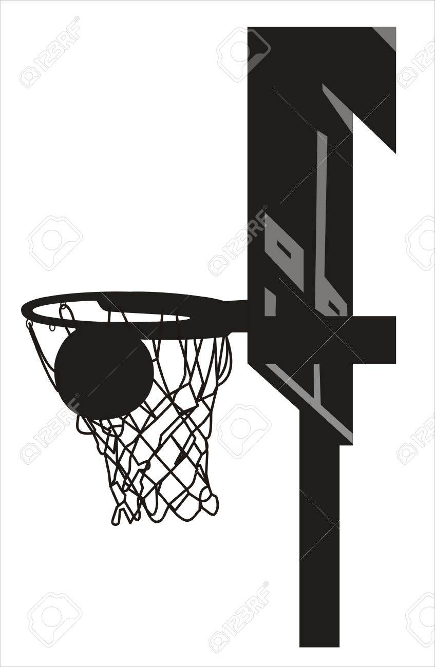 silhouette of a basketball going into the basket stock photo
