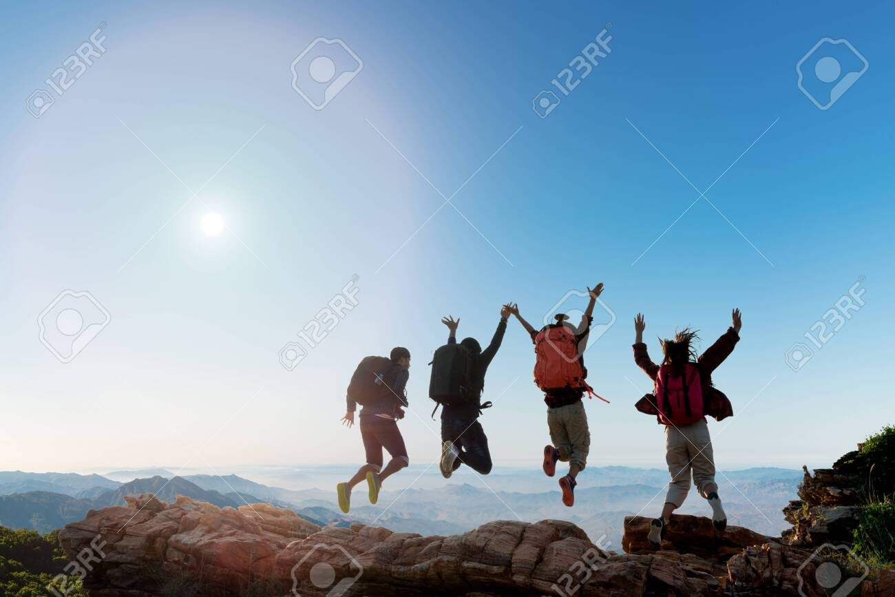 Group of happy hiker jumping on the hill. hiking holiday, wild adventure - 126573019