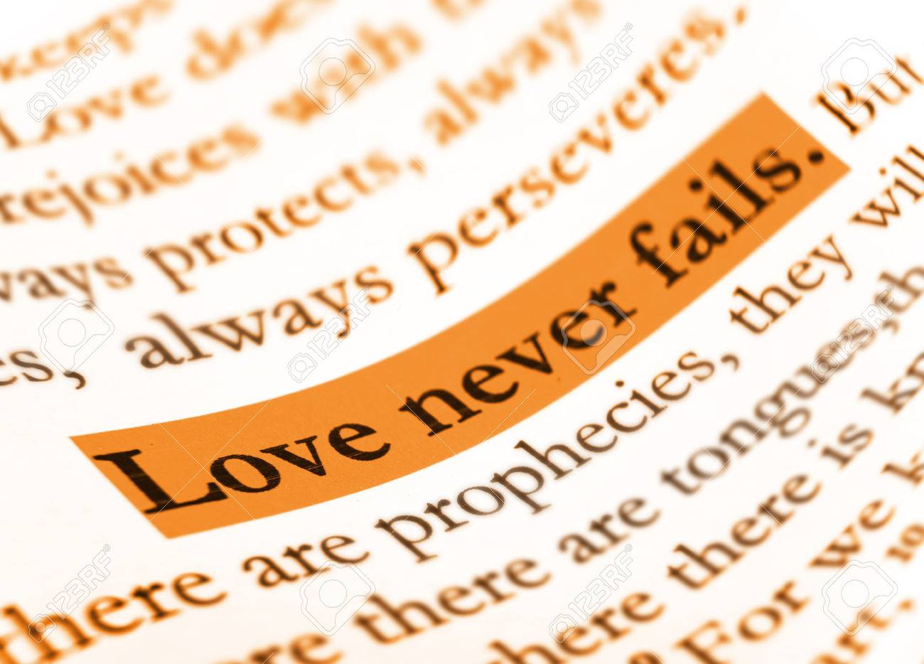 Love never fails on Holy bible. Stock Photo - 28635729