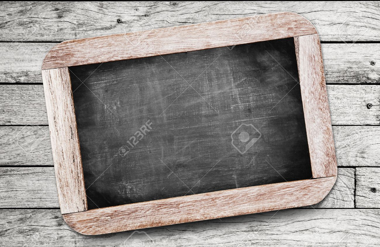 Small black chalkboard on wood background Stock Photo - 30179876