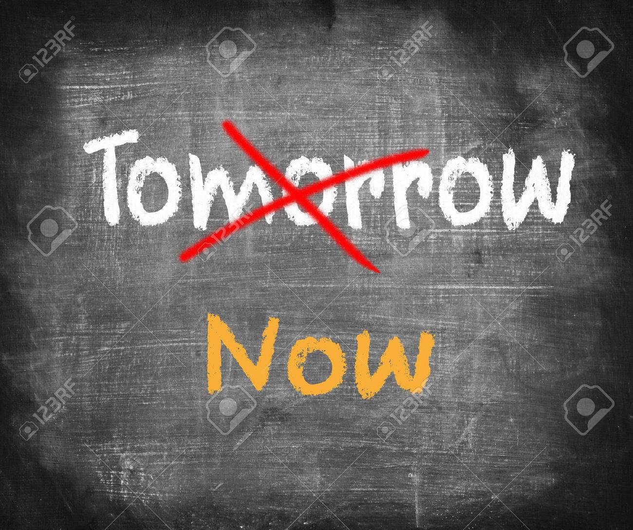 Word Now written instead of Tomorrow. Procrastination concept Stock Photo - 30208437
