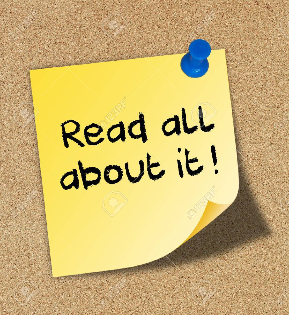 Read all about it written on yellow note pinned on cork board Stock Photo - 30615341