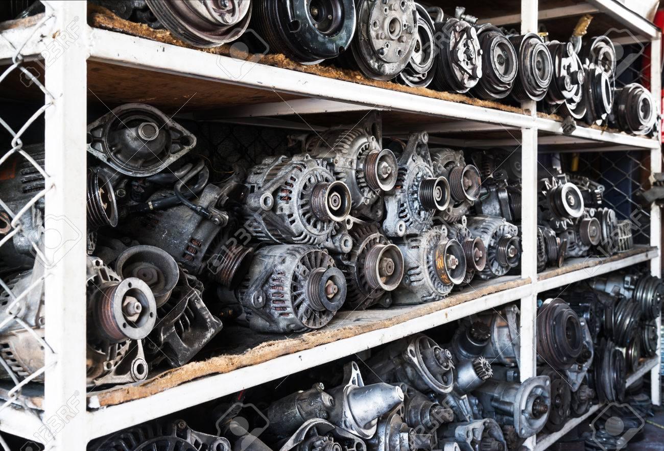 Old car alternators on shelf. Stock Photo - 50234638