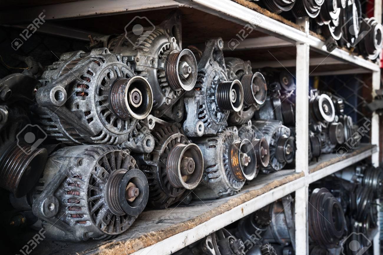 Old car alternators on shelf. Stock Photo - 50234644