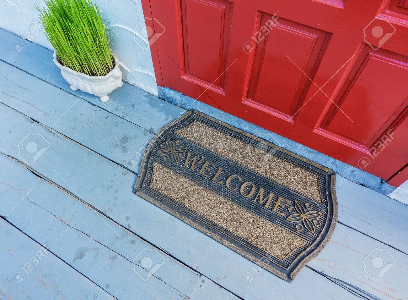 Welcome mat outside the front door Stock Photo - 69343977