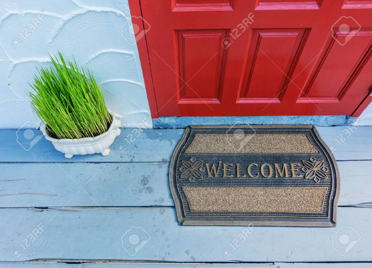 Welcome mat outside the front door Stock Photo - 69343989