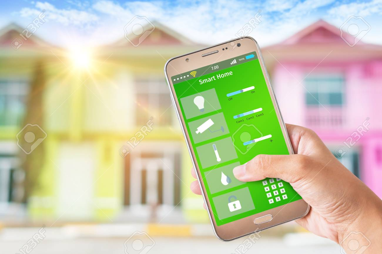 Woman Using Smart Phone As Smart Home Control Application Over ...