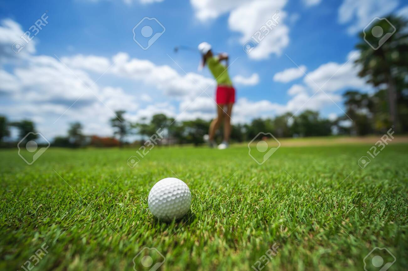 Golf girl player hitting ball on professional golf course. - 149587717