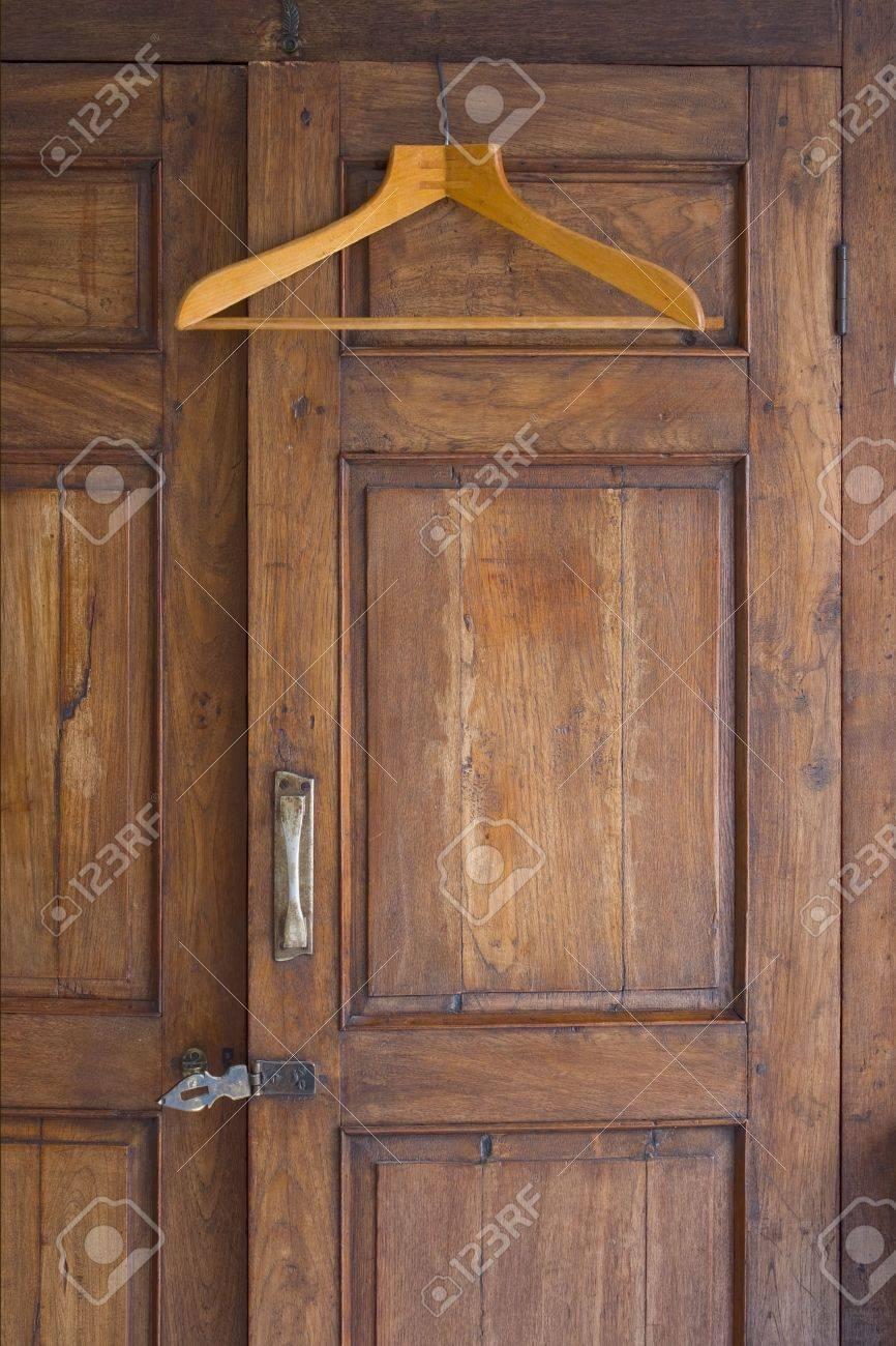 Wooden Hanger On Door Of Antique Closet Stock Photo   3106719