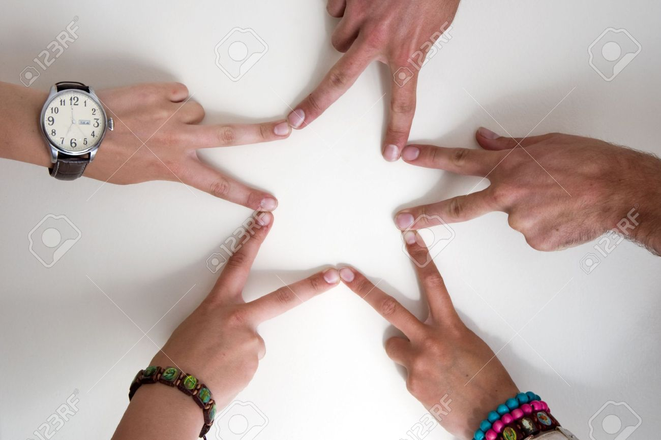 five teenagers hands form a star two boy hands and three girl