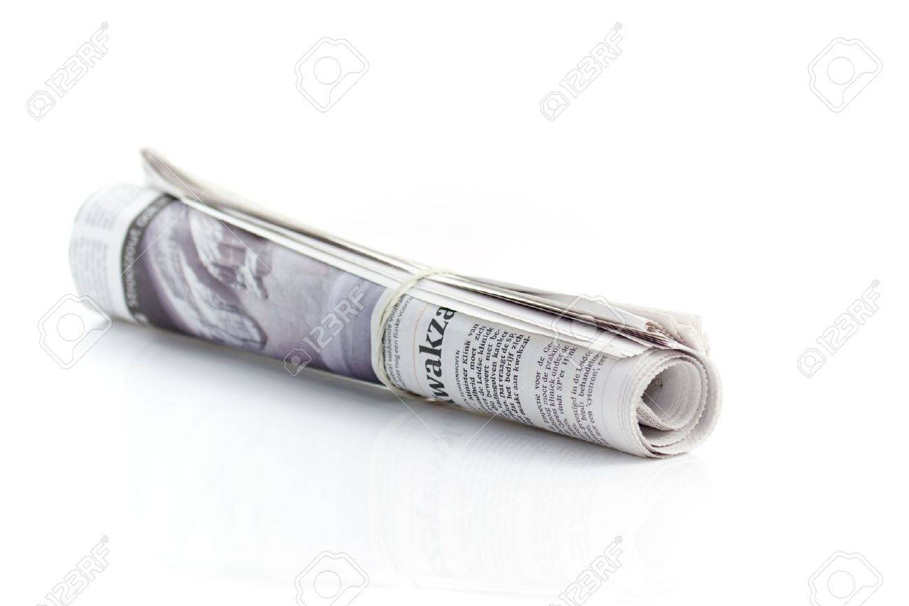 Rolled Up Newspaper With Rubber Band Stock Photo, Picture And ...