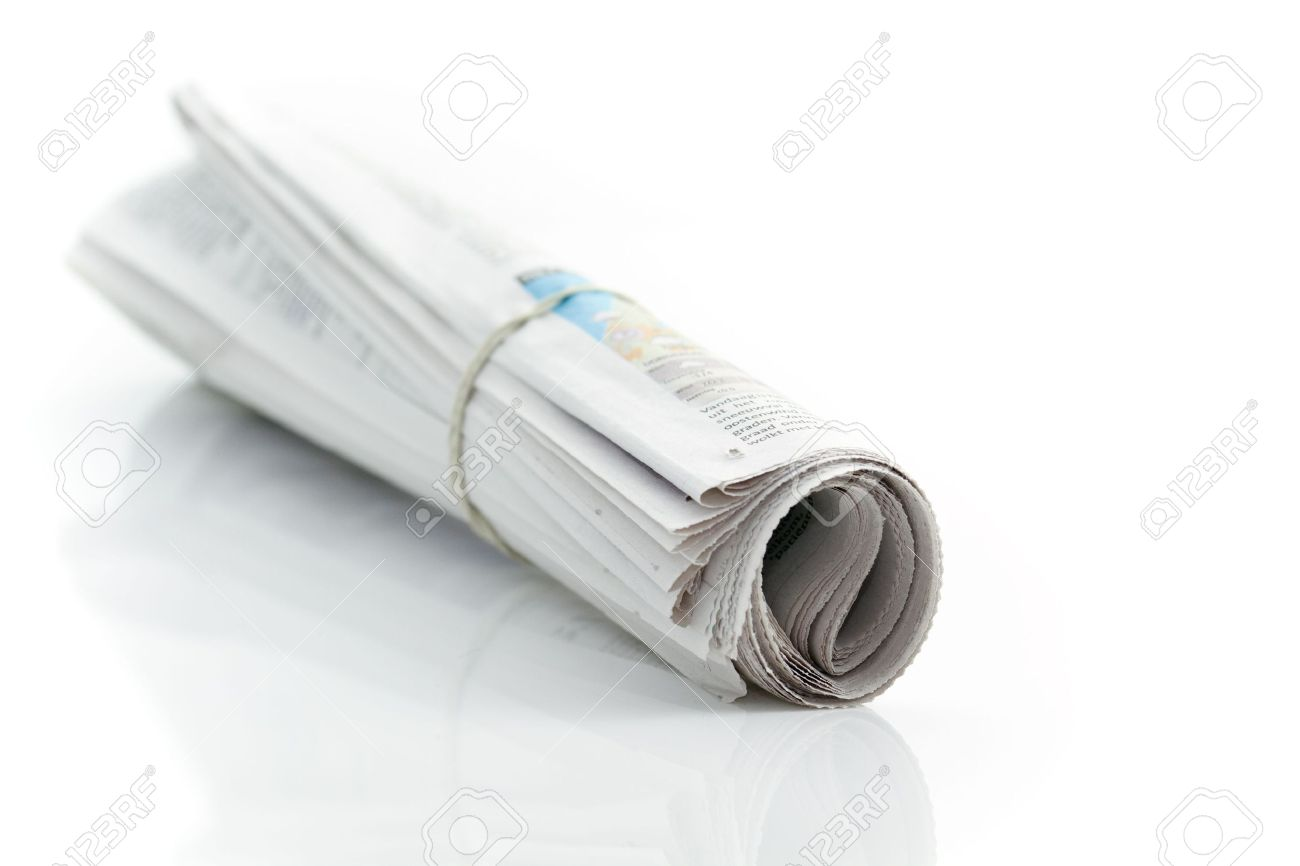 Rolled up newspaper with rubber band Standard-Bild - 6258608