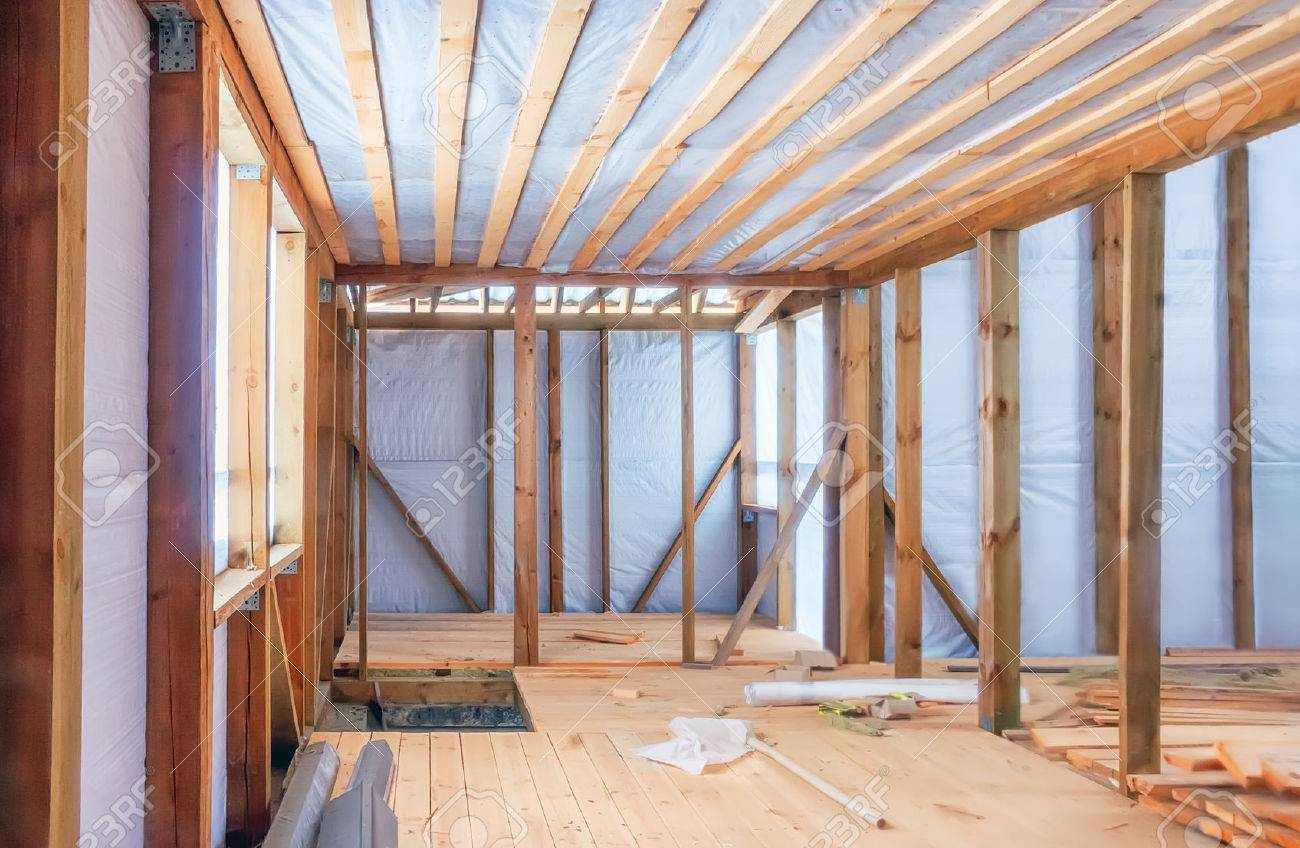 Frame Construction Of A Wooden House Using A Vapor Barrier. Inside ...