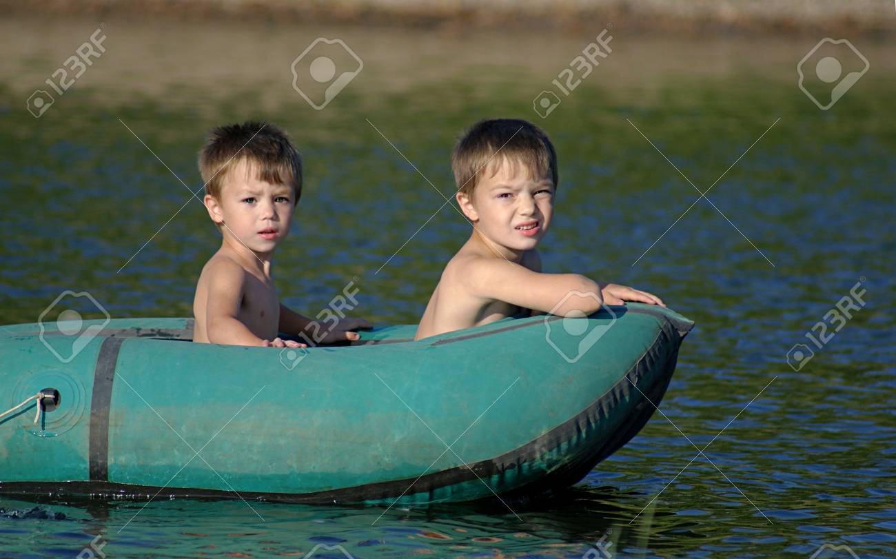 Children in a boat Stock Photo - 6661565