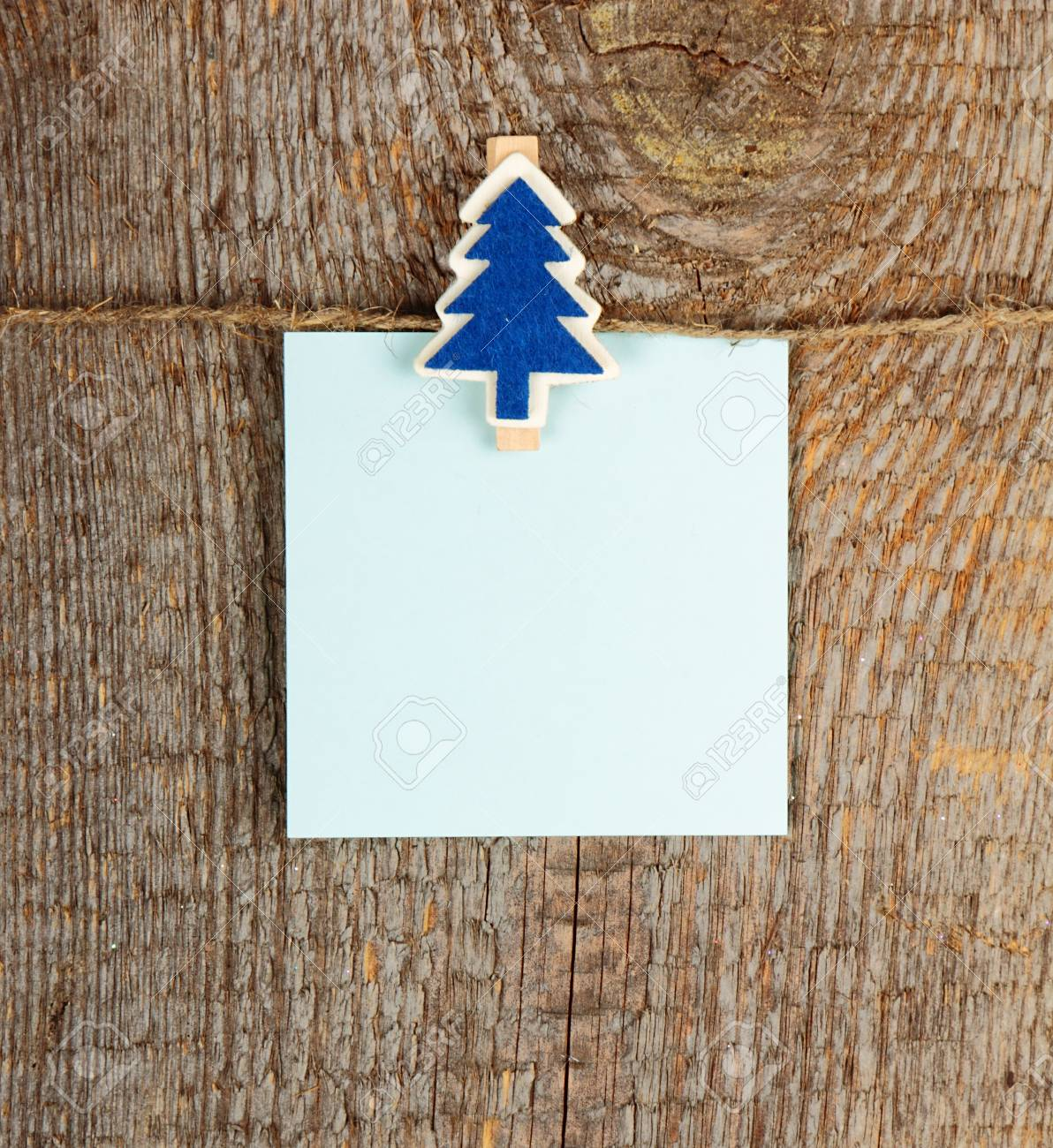 Clothes-peg in shape of Christmas tree on old wooden background Stock Photo - 24368311