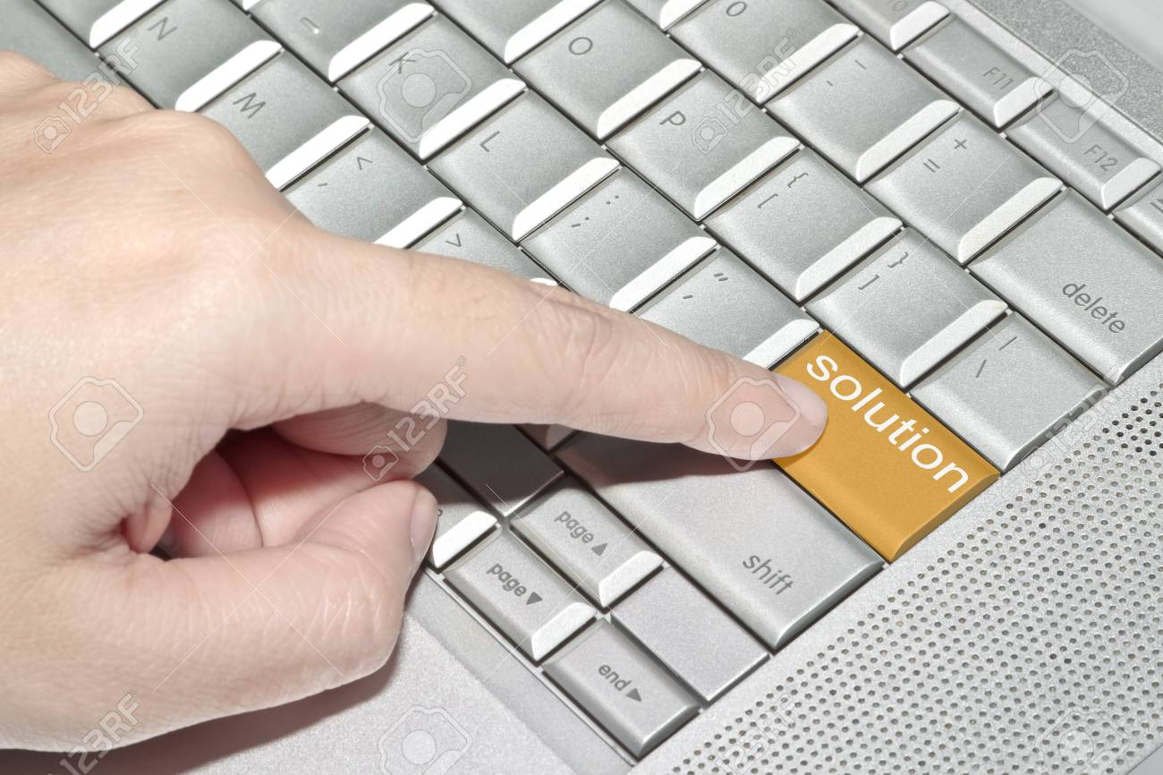 Hand pressing on solution word with yellow keyboard button Stock Photo - 10714257