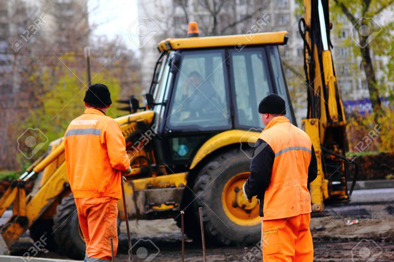 Road workers. The asphalt. Stock Photo - 11806440