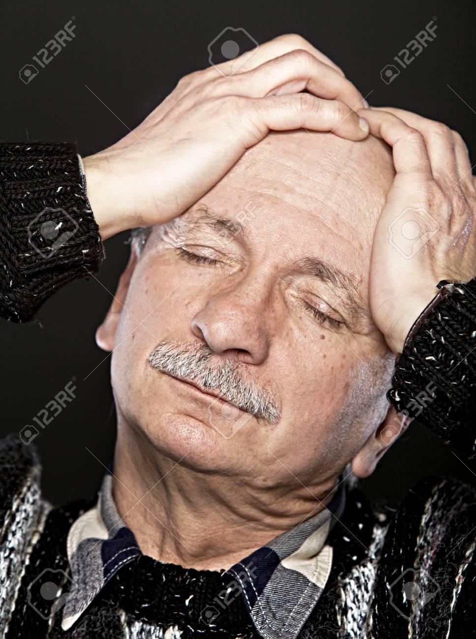Depression. Elderly man suffering from a headache Stock Photo - 12723790