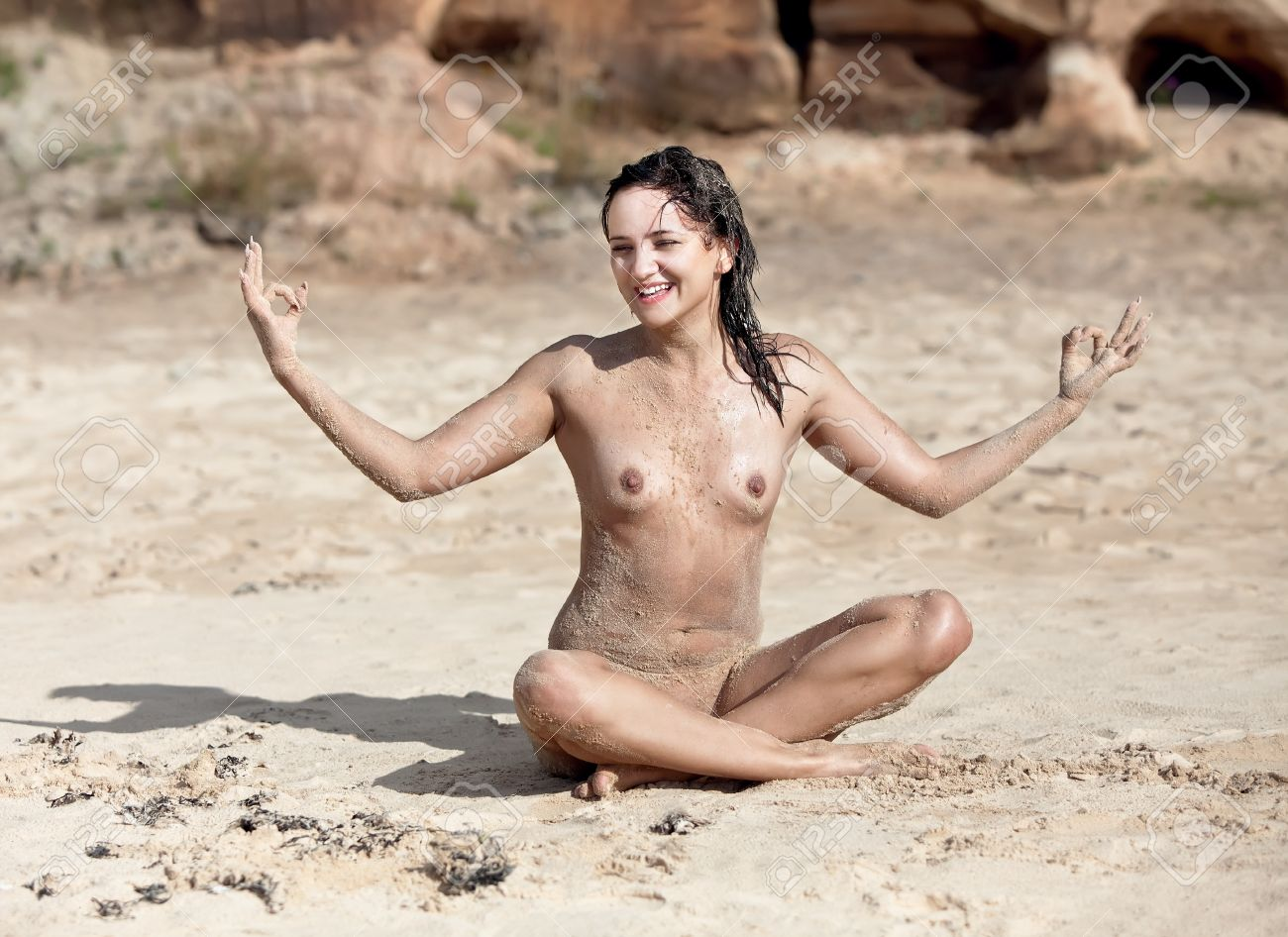 sand naked Naked Yoga. Young woman sitting naked on sand Stock Photo - 12729356