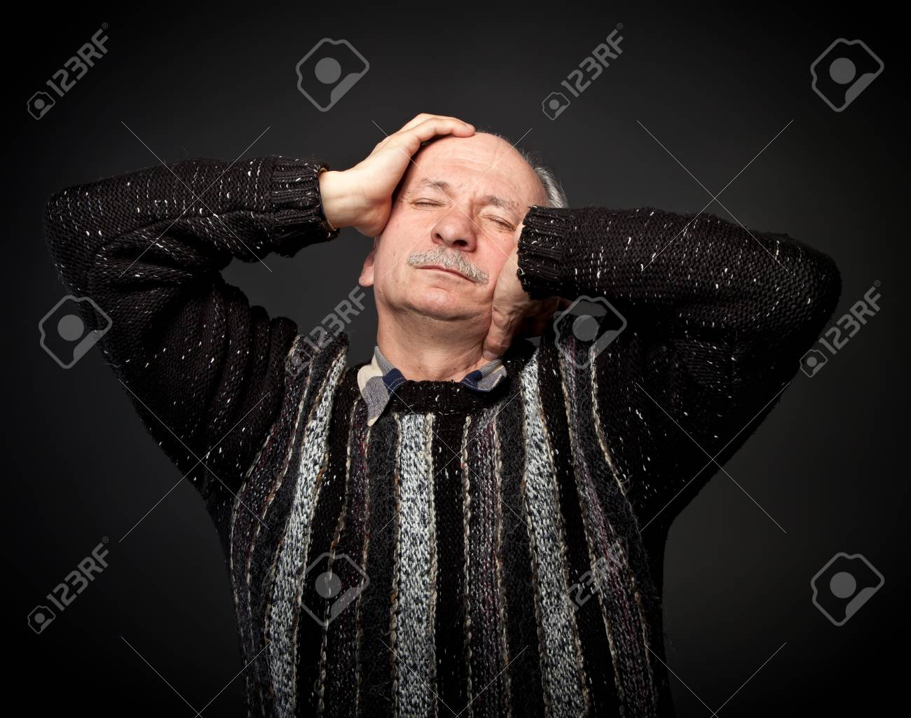 Elderly man suffering from a headache Stock Photo - 13652652