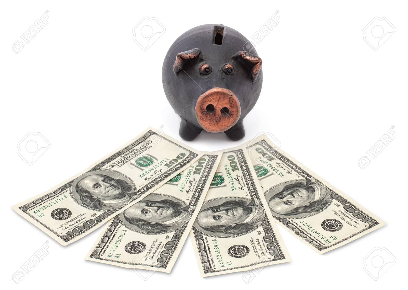 Money and black piggy bank on white background Stock Photo - 16562810