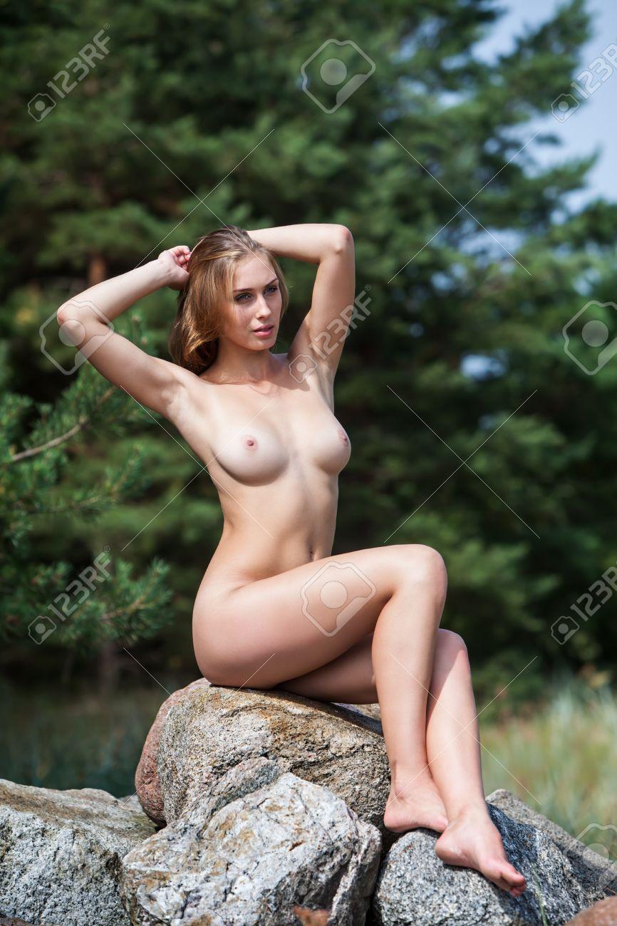 nude-girls-sitting-on-rock