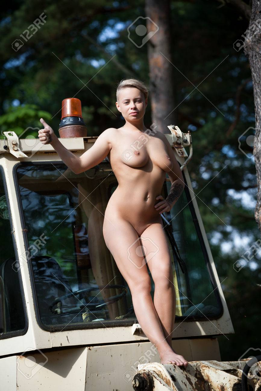 lesbien-porn-woman-posing-nude-with-tractor-and