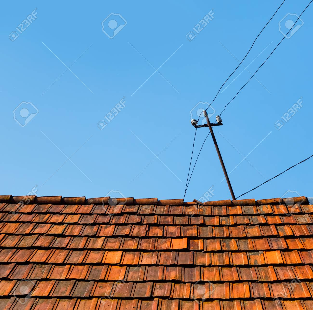Old Tiled Roof Of A Village House. Red Tile And Power Line Wires ...