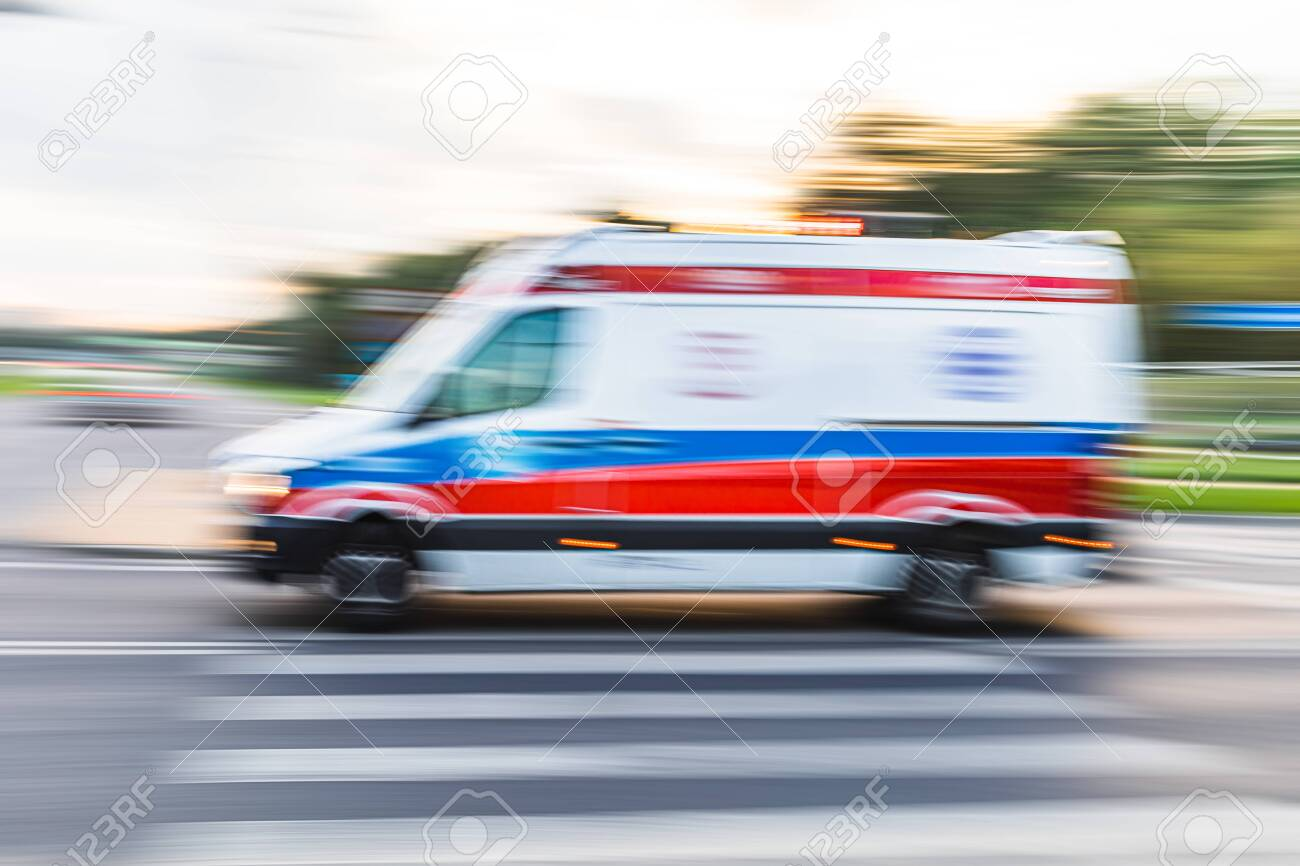 Ambulance on emergency call in motion blur. Ambulance in the city on a blurred background - 133249613
