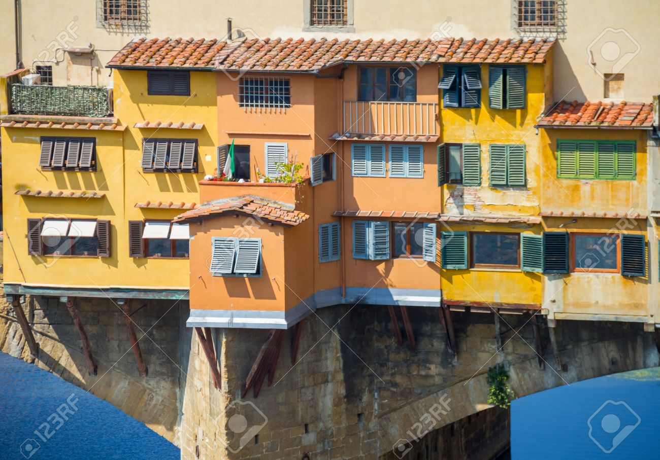 Beautiful Traditional Italian Houses On The Bridge Appear To Be Hanging Over Arno River