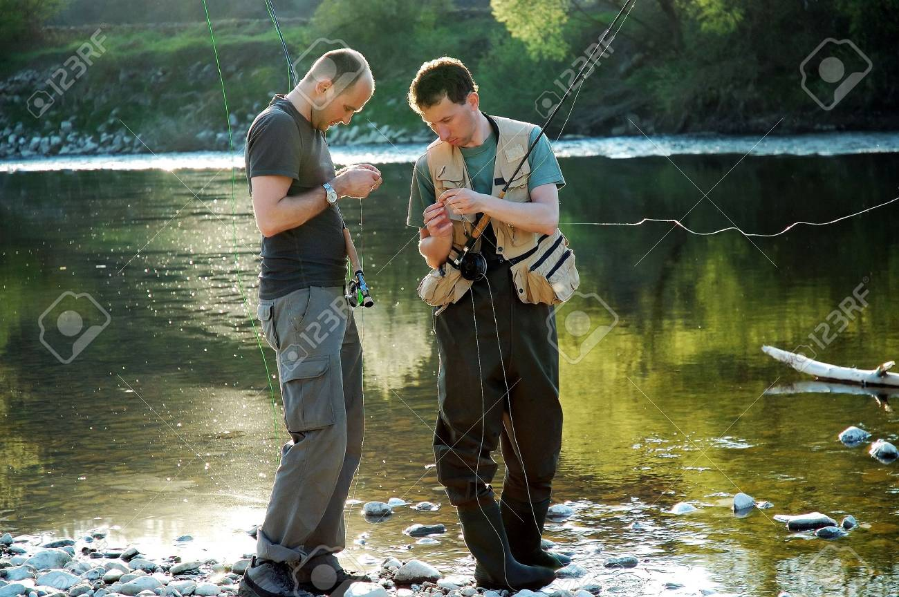 Two fisherman make ready angling on the river Stock Photo - 1320915