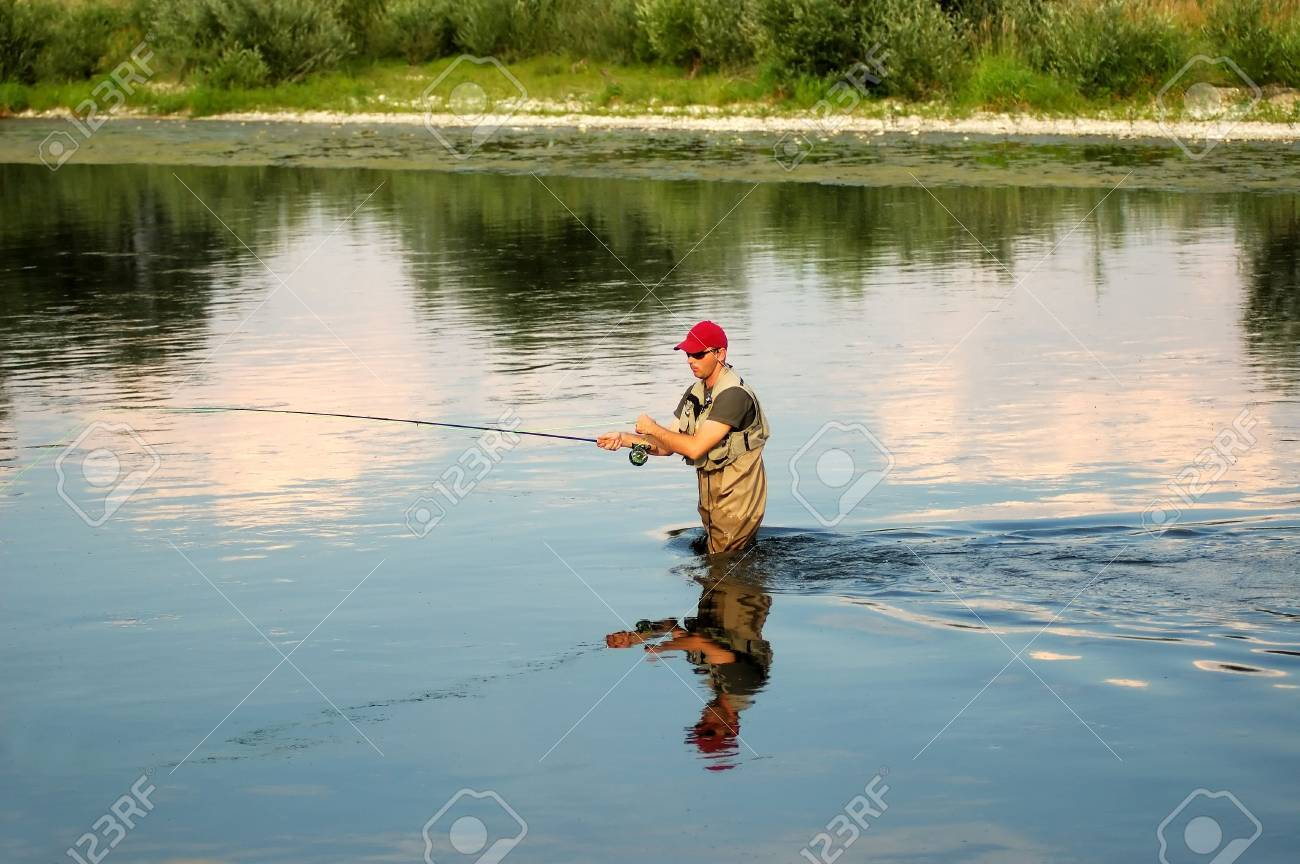 Fisherman angling on the river Stock Photo - 1320936