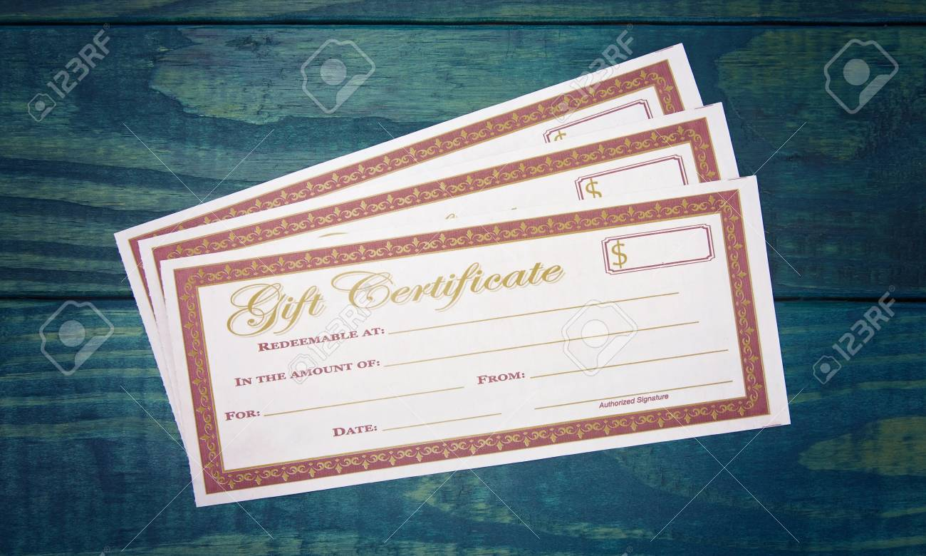 blank gift voucher on a blue wooden table stock photo picture and