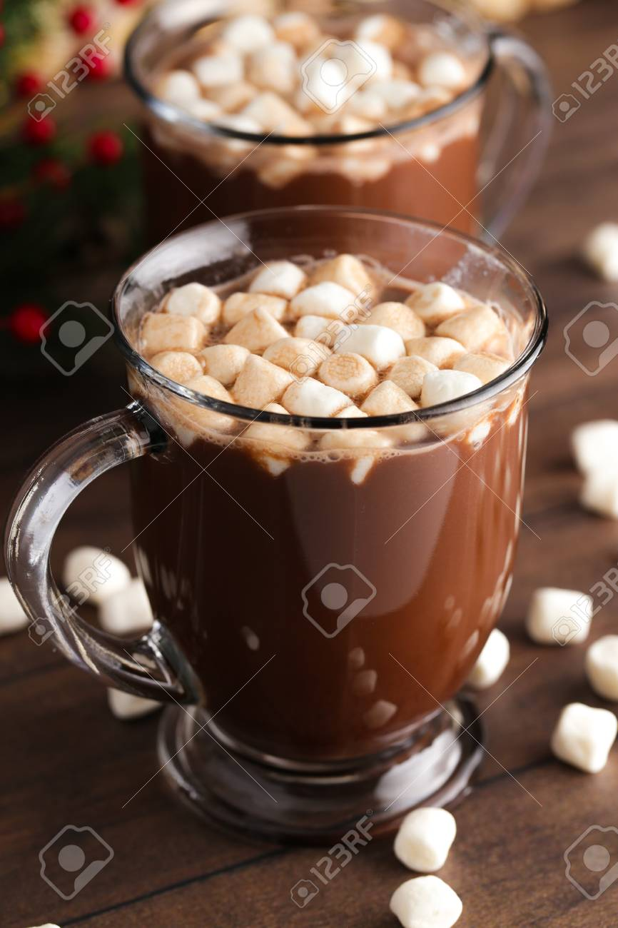 A Pair of Mugs Filled with Hot Chocolate and Marshmallows on a Wooden Table - 112030857