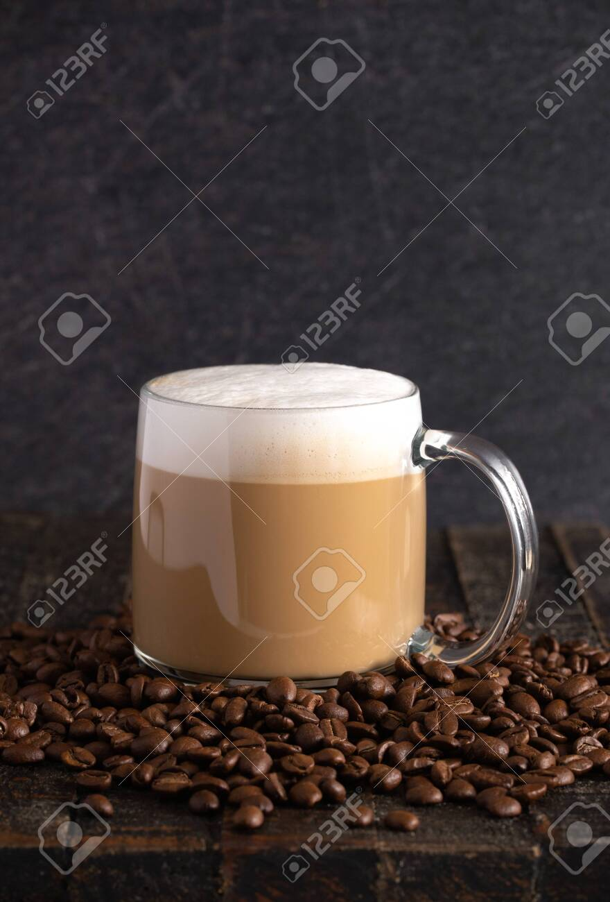 A Cafe Latte Coffee In A Clear Glass Mug In A Dark Environment Stock Photo Picture And Royalty Free Image Image 121197181