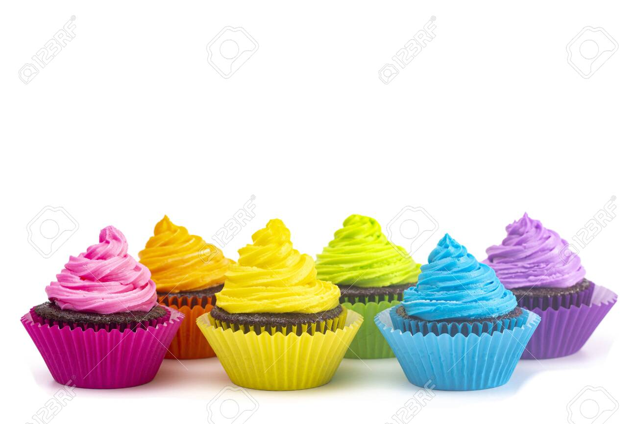 Rainbow Colored Frosted Chocolate Cupcakes Isolated on a White Background - 124716615