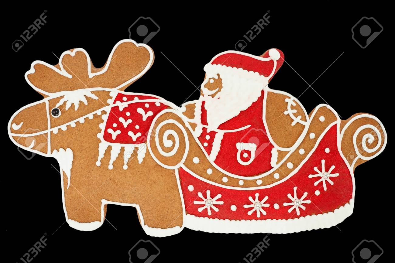 Santa Claus gingerbread isolated on black Stock Photo - 9329191