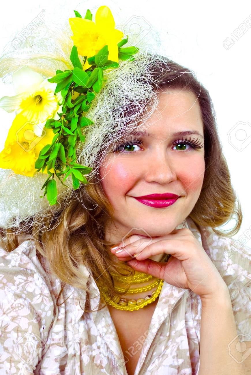 Beautiful smiling girl with narcissus in her hair Stock Photo - 854114