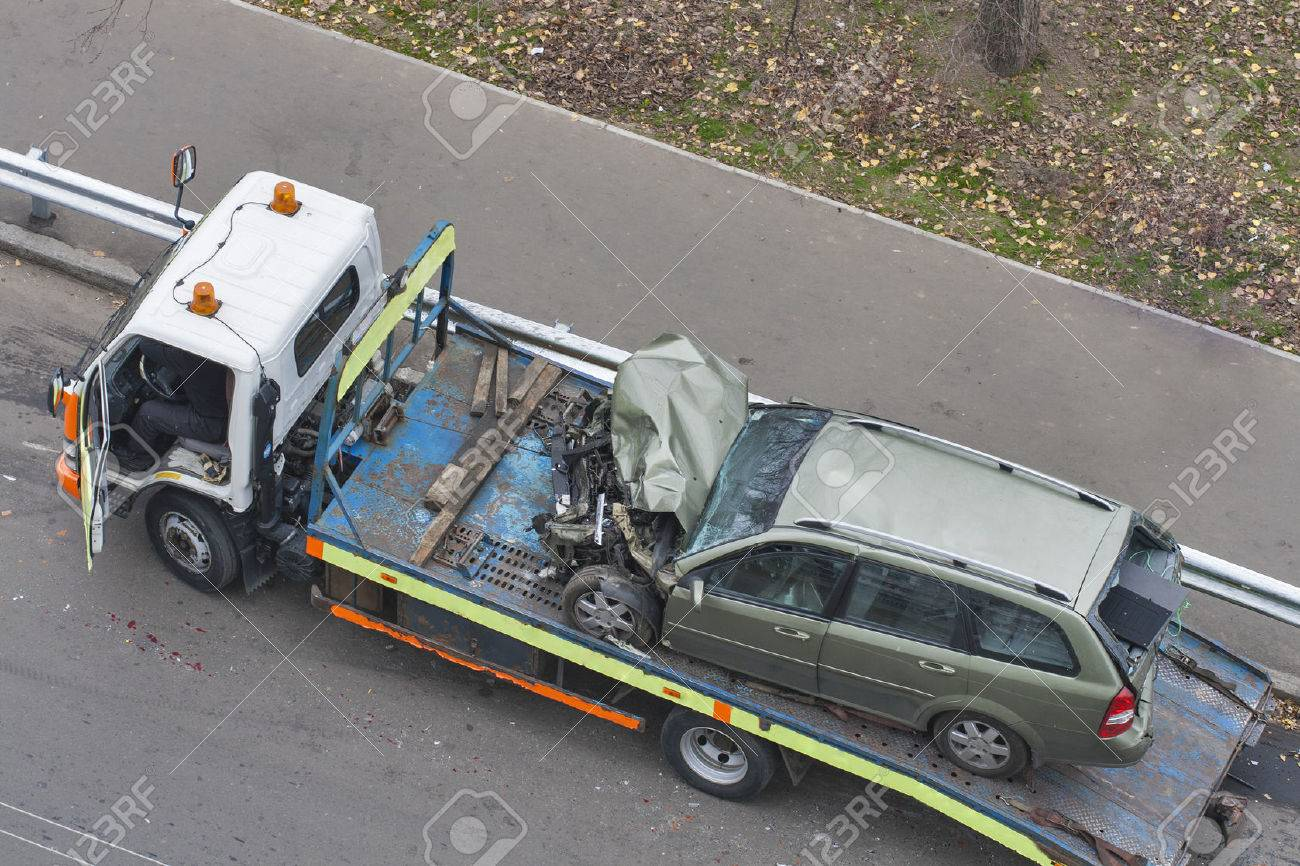 car broken during a road accident shipped to a car wrecker Stock Photo - 24390708