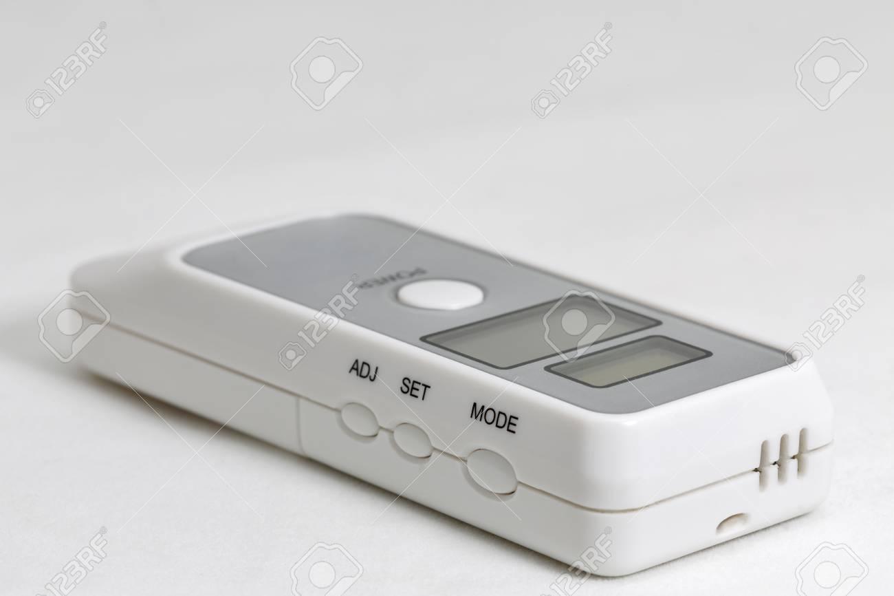 Portable Breath Alcohol Tester On White Background Closeup Stock P O 61714756